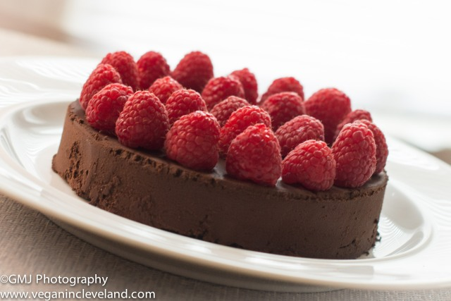 Flourless vegan chocolate cake with raspberries
